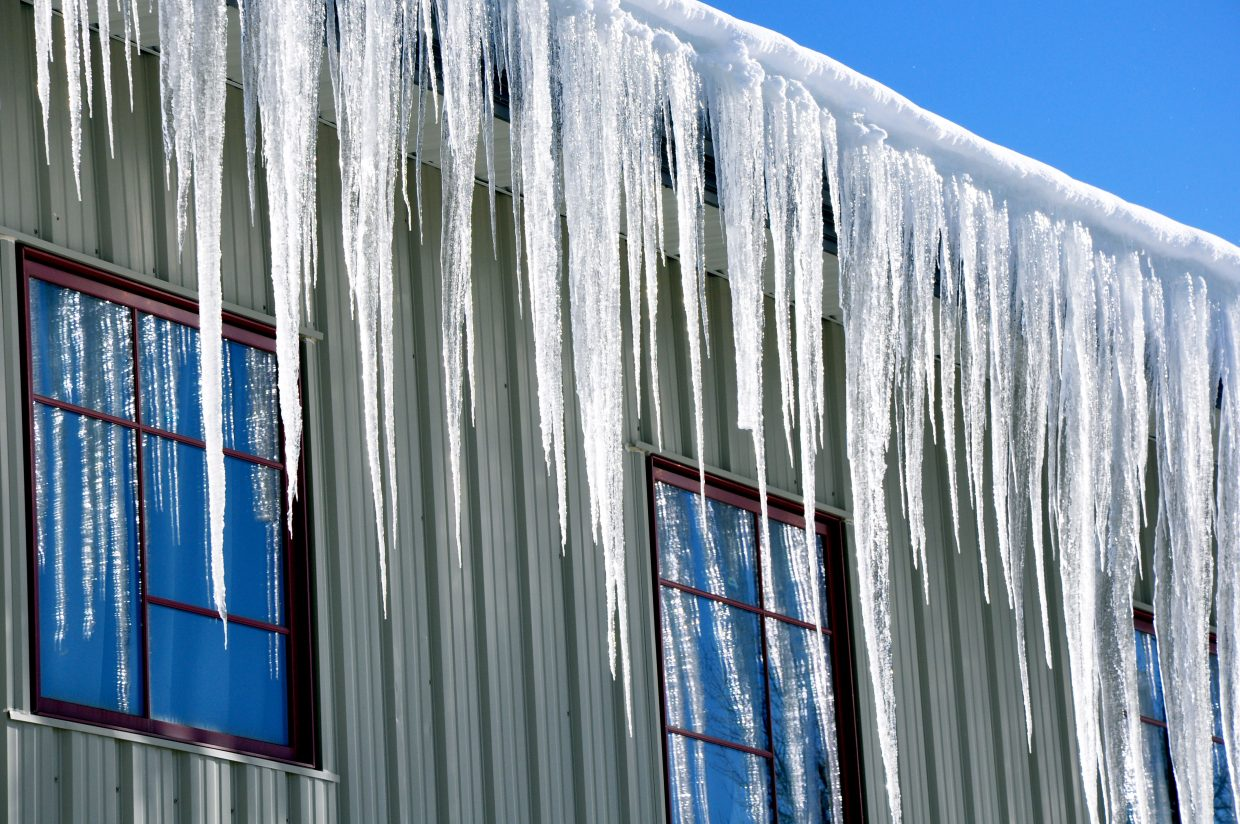 Icicles hang from a rooftop in Steamboat Springs on Wednesday afternoon.