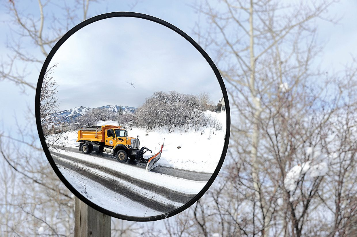 A plow truck clears snow along Steamboat Boulevard on Monday afternoon in Steamboat Springs.