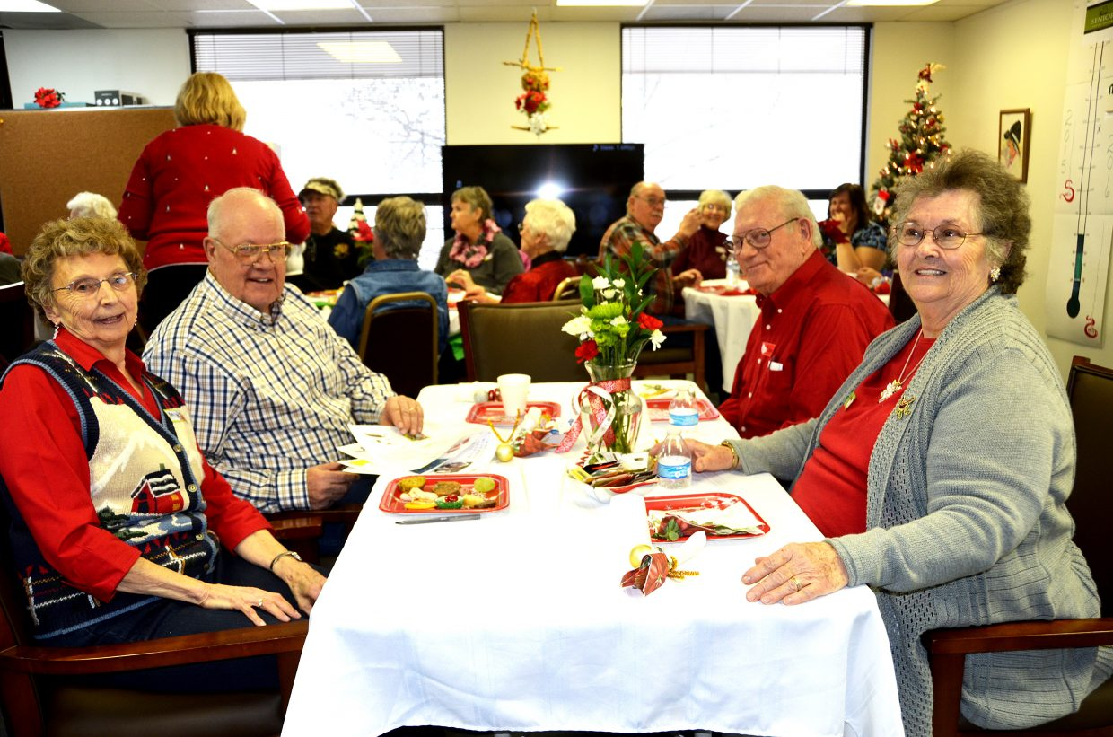 The Senior Social Center hosted Christmas Tea on Dec. 22. Marilyn Stevens, left, sits with husband Walt Stevens. On the right side of the table Carroll Levitt sits with wife Norma Levitt.