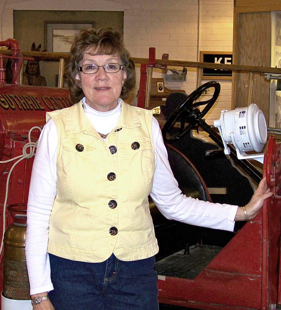 Retiring Assistant Director Janet Gerber poses in the Museum of Northwest Colorado.