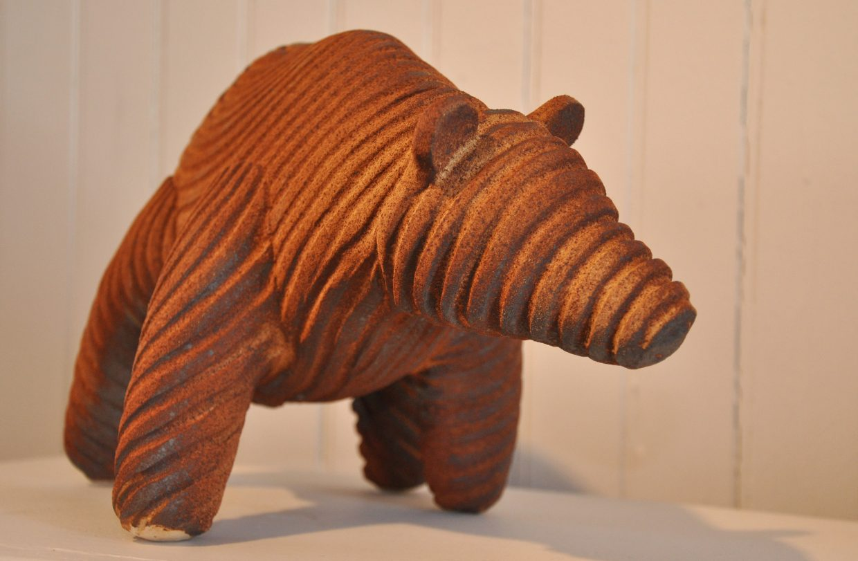 A clay bear made by Bill Sanders is one of the pieces on display at a new art show in the Depot Art Center in Steamboat Springs. The show also features prints, weavings and photography.