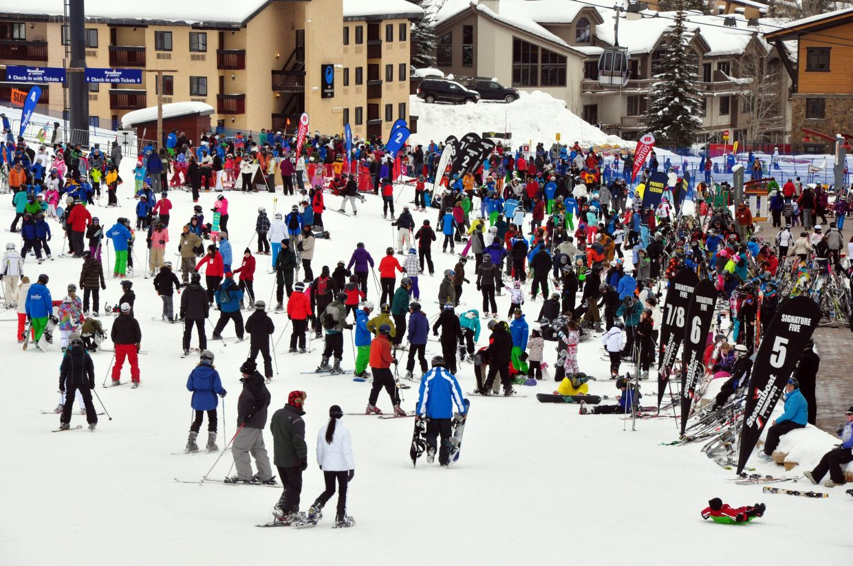 A huge crowd of skiers and riders congregate at the base of the Steamboat Ski Area in 2014.