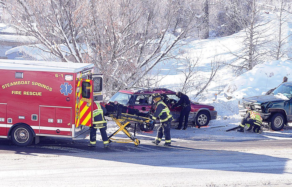 Members of Steamboat Springs Fire Rescue load a man into a waiting ambulance after a two-car crash Thursday on U.S. Highway 40 near the intersection with Indian Trails. Steamboat Springs police officers at the scene said the Subaru that was traveling west apparently hit an icy patch on the roadway and slid into a GMC pickup that was traveling east. The driver of the pickup also suffered minor injures but refused to be transported from the scene. Names were not available.
