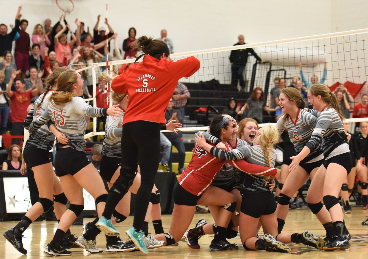 The Steamboat Springs High School volleyball team celebrates a victory at Battle Mountain. The win secured a first-place finish in the Western Slope League, the team's first league championship since 2002.
