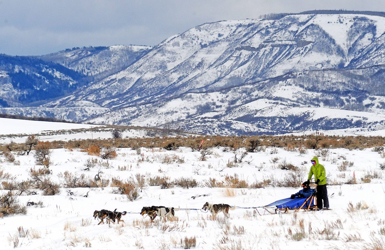 Josh Winward drives a dog sled around Stagecoach Reservoir on Monday. The dog sledding tour allows outdoor enthusiasts to drive sleds pulled by dogs from the Double T Kennel. Some of the dogs are Iditarod dogs. Learn more about the tours and the dogs at dogsleddingsteamboat.com.