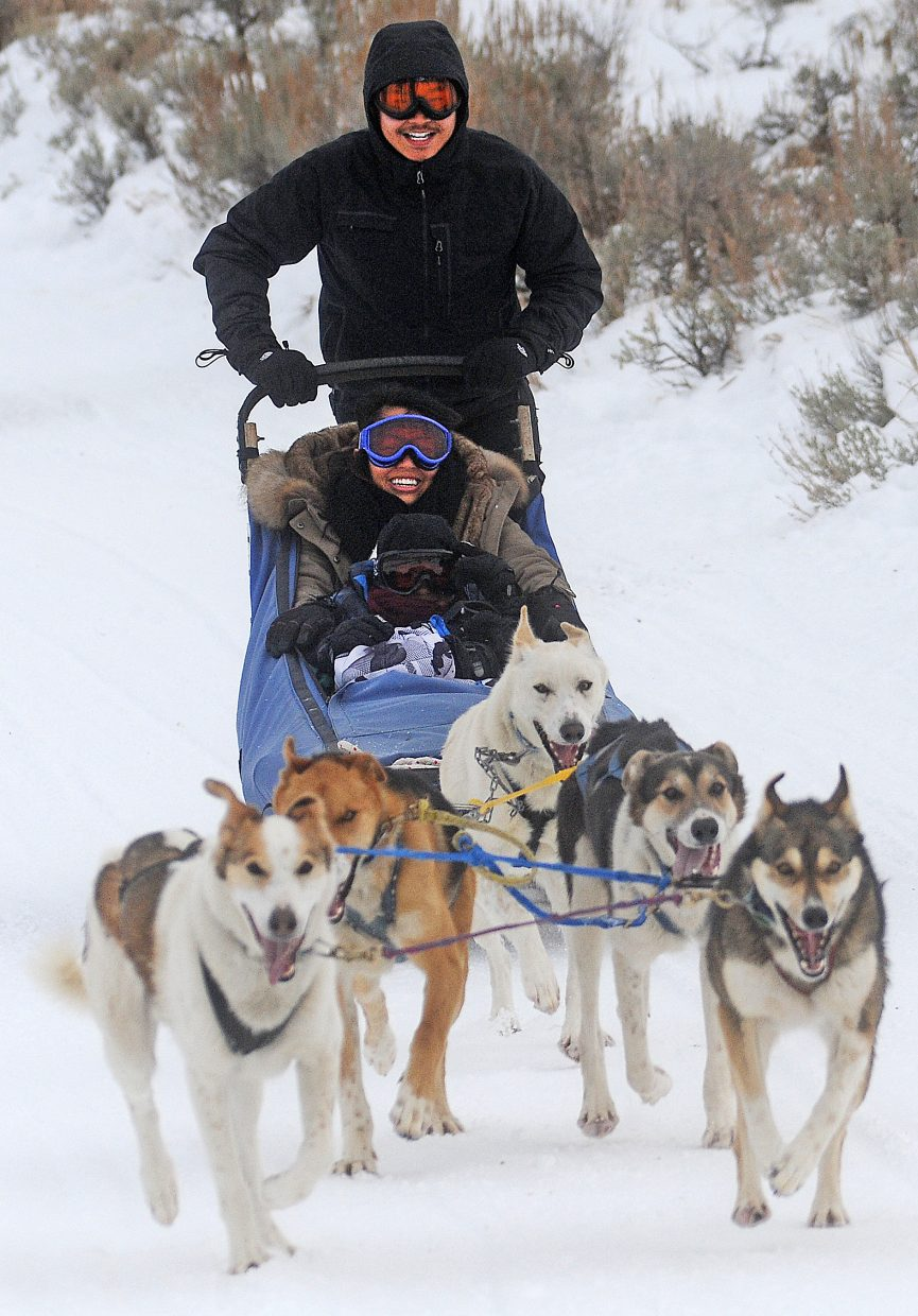 Paul Tran drives a dog sled Monday around Stagecoach Reservoir on Monday during a tour operated by Double T Kennel in Oak Creek.