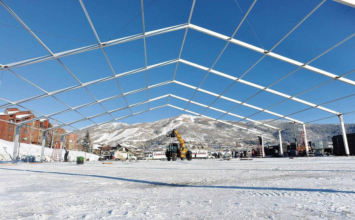 Crews from Event Rents set up a tent for the Steamboat Springs MusicFest, which kicks off Tuesday at the Steamboat Ski Area. The Festival will take place Jan. 5-10 and will include 60 bands.
