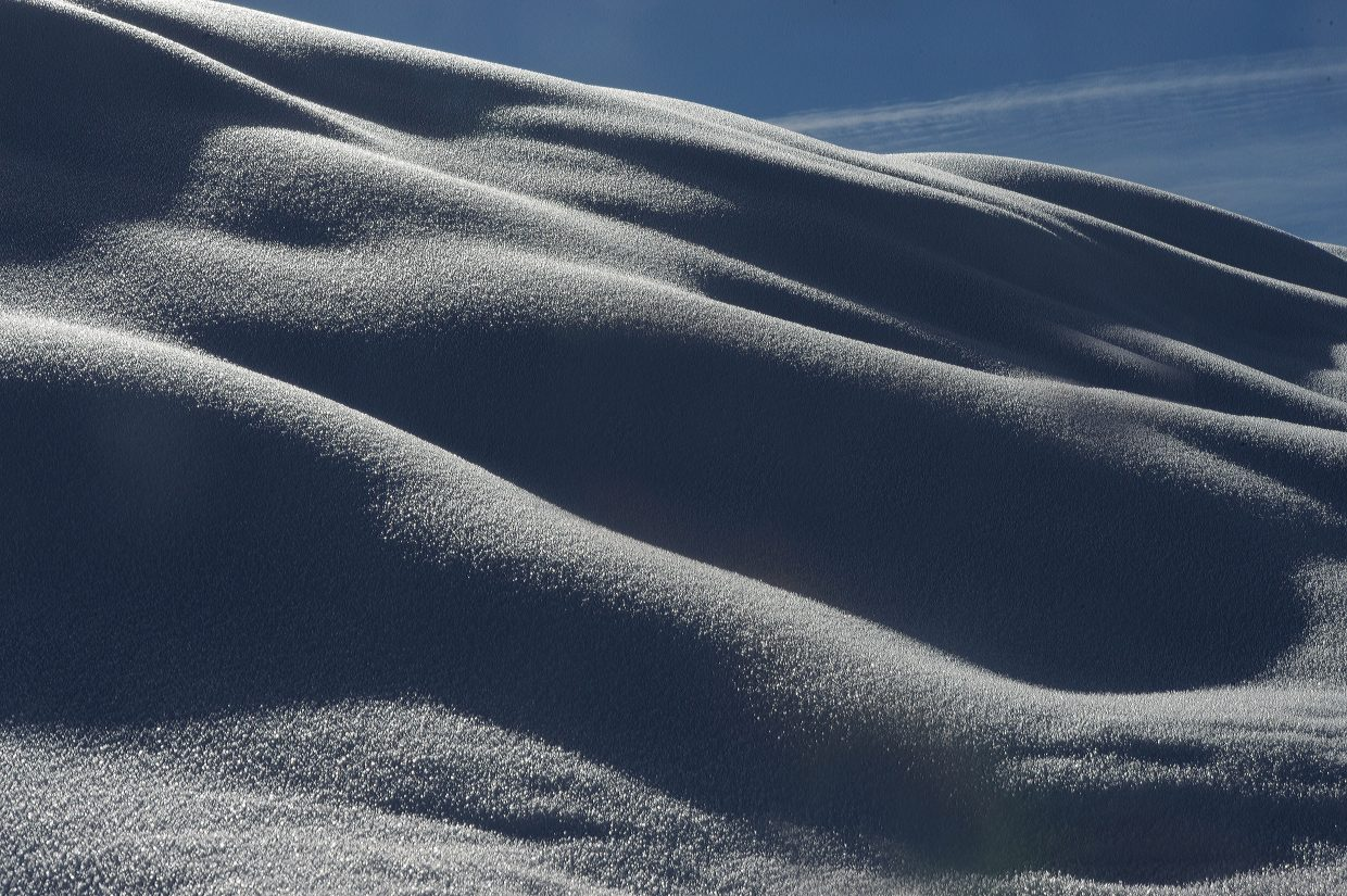 Mid-morning light gives shape to pillows of snow along Amethyst Drive in Steamboat Springs Monday morning.