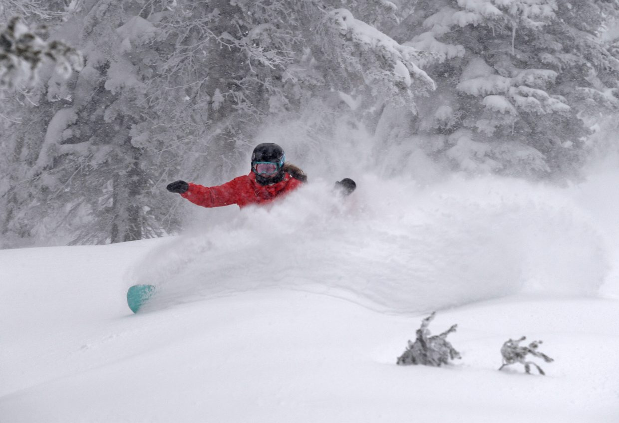 Cloud kicker: Steamboat Springs Winter Sports Club snowboard director Tori Koski cuts through Closets on Wednesday as the powder fell at Steamboat Ski Area. The resort had 8 inches of the fresh stuff Wednesday morning and that was before it snowed all day and into the night.