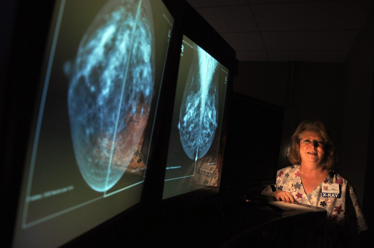 Julie Isaacs, formerly the women's imaging coordinator at Yampa Valley Medical Center, stands at one of the hospital's mammography reading work stations in 2012. The hospital recently earned a national accreditation for its cancer treatment services.