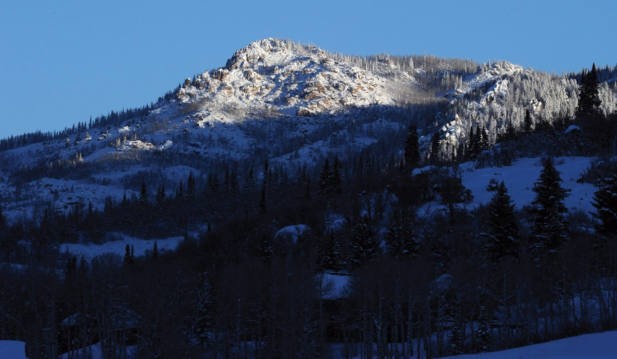 The early morning sunlight catches the top of a peak near Strawberry Park on Monday morning. Residents were greeted by below freezing temperatures, but the sun did help warm up the afternoon if only slightly.
