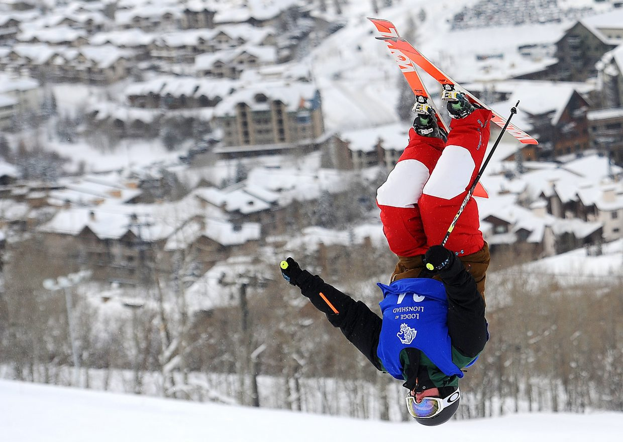 Avital Shimko flips over the bottom jump on the Voo Doo moguls course Sunday in Steamboat Springs. She went on to finish third in the event, a dual moguls competition.