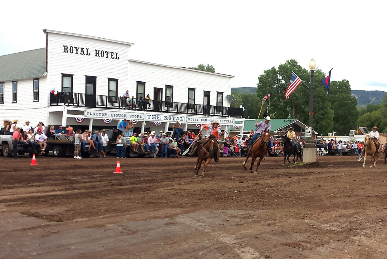 Cowboys celebrate a traditional Fourth of July in 2014 by playing broom polo along the town of Yampa's Moffat Avenue in front of the Royal Hotel. The hotel, which is on the Routt County Register of Historic places, and built in 1903, burned down early Sunday morning. The nearby Community Church and the U.S. Post Office were saved by firefighters.