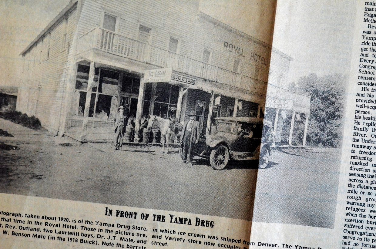 Pictured in this photograph of the Royal Hotel in Yampa taken in about 1920 are Rev. Outland and his white horse, the two Laurienti boys (background), Dr. J.T. Maile, standing in front of a 1918 Buick, and W. Benson Male, behind the wheel.The barrels on the boardwalk were used to ship ice cream from Denver to the drug store in the hotel.