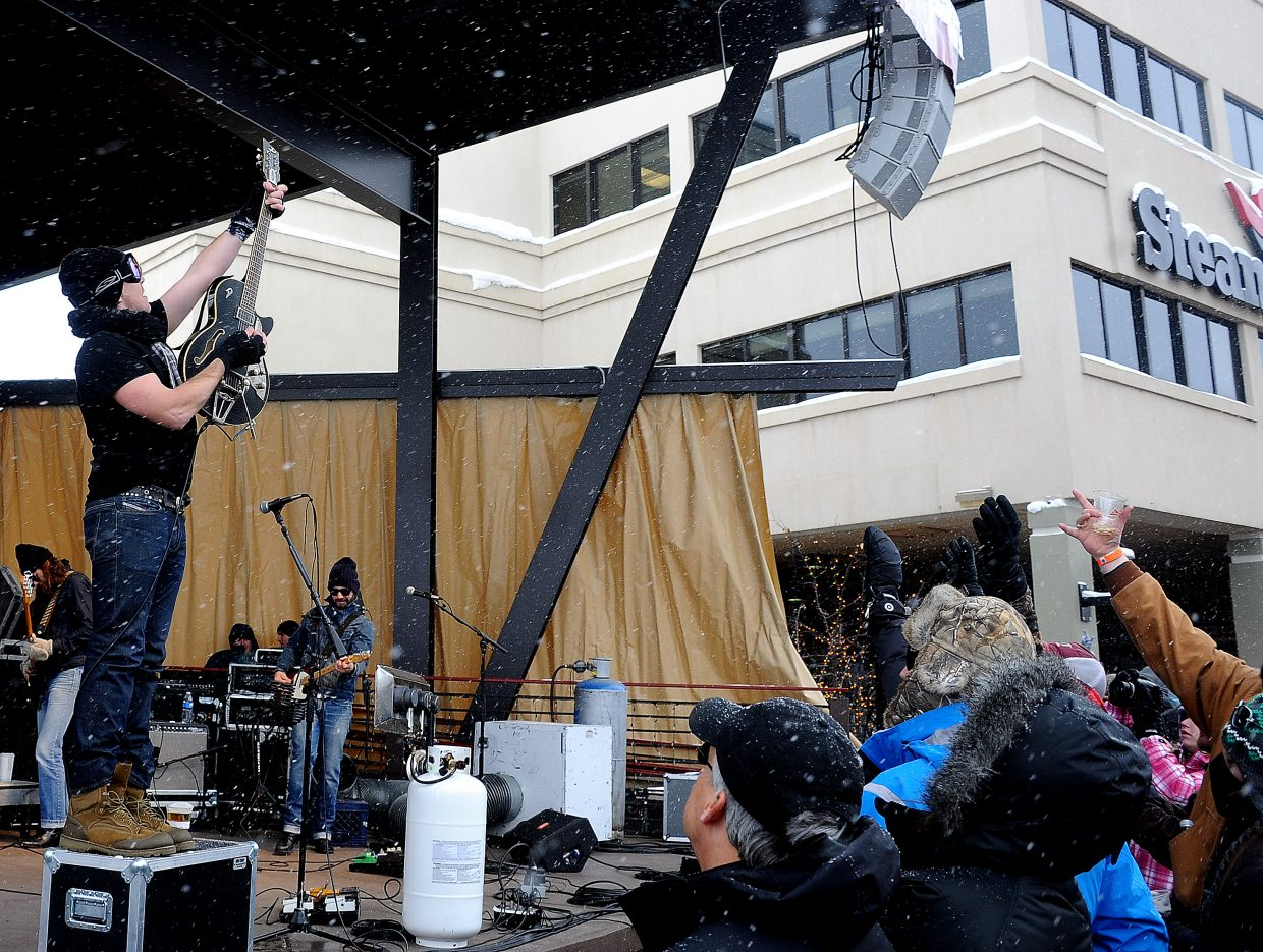 Jack Ingram and a hoard of eager fans welcome the snow Sunday afternoon at the base of Steamboat Ski Area during a free concert associated with MusicFest in Steamboat Springs.