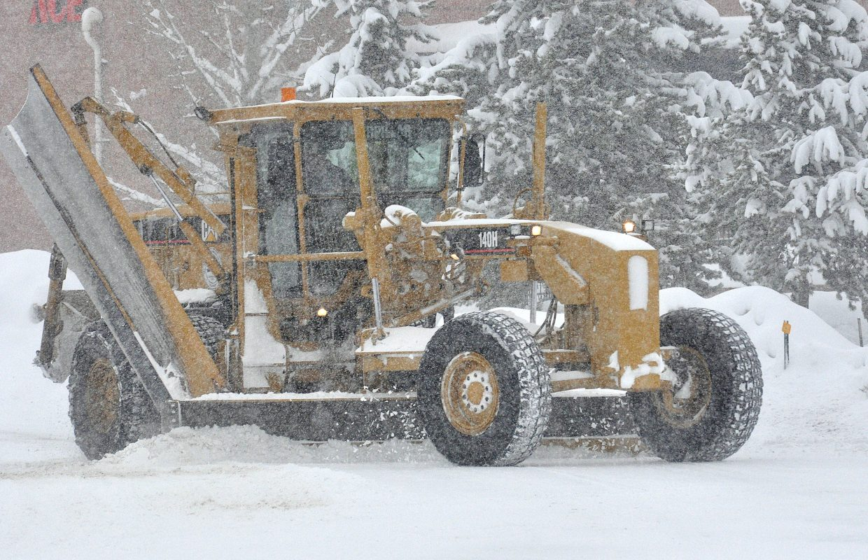 A road grader clears snow from a street in west Steamboat Springs on Wednesday.
