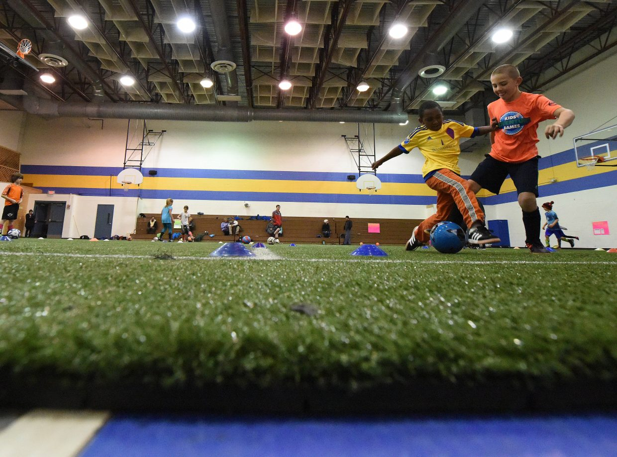 The Steamboat Soccer Club's U9-U10 players kick their way through a class Thursday at the Mountain Village Montessori Charter School gymnasium west of Steamboat Springs. The club leased the space from the school and put down indoor turf to allow all-season workouts.