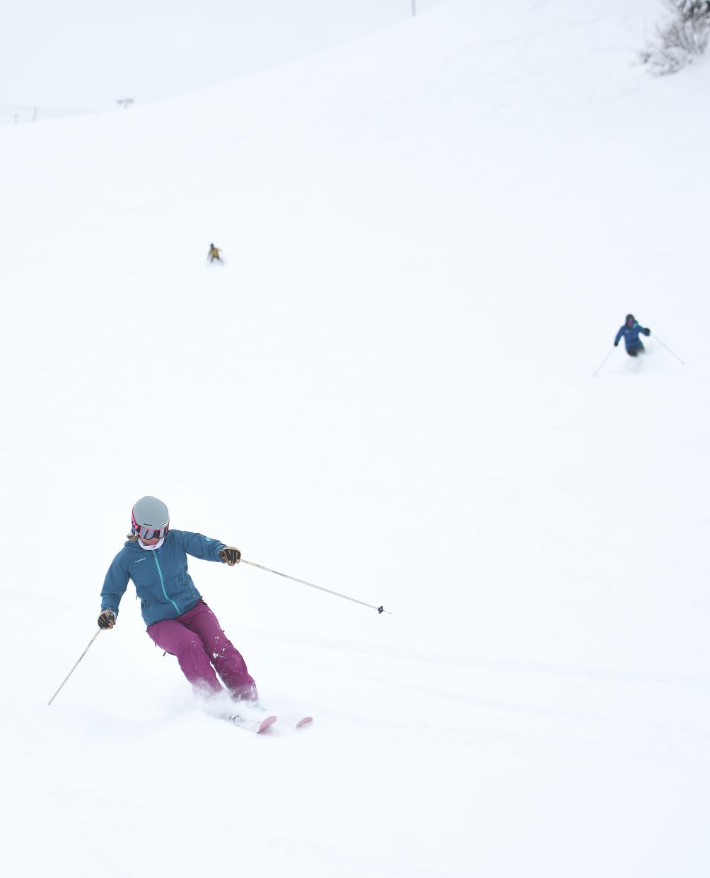 Skiers cut down the face of Howelsen Hill Thursday morning after a winter storm covered the downtown Steamboat Springs hill with powder.