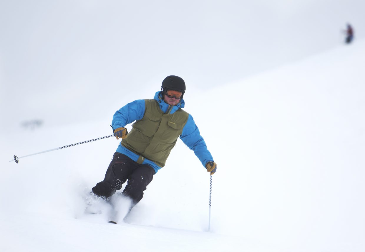 Eric Friese, director of operations for the Steamboat Springs Winter Sports Club, skis through the powder at Howelsen Hill. While many rushed to Mount Werner, some of those who work on or near Howelsen Hill turned to it for some of the day's plentiful powder.