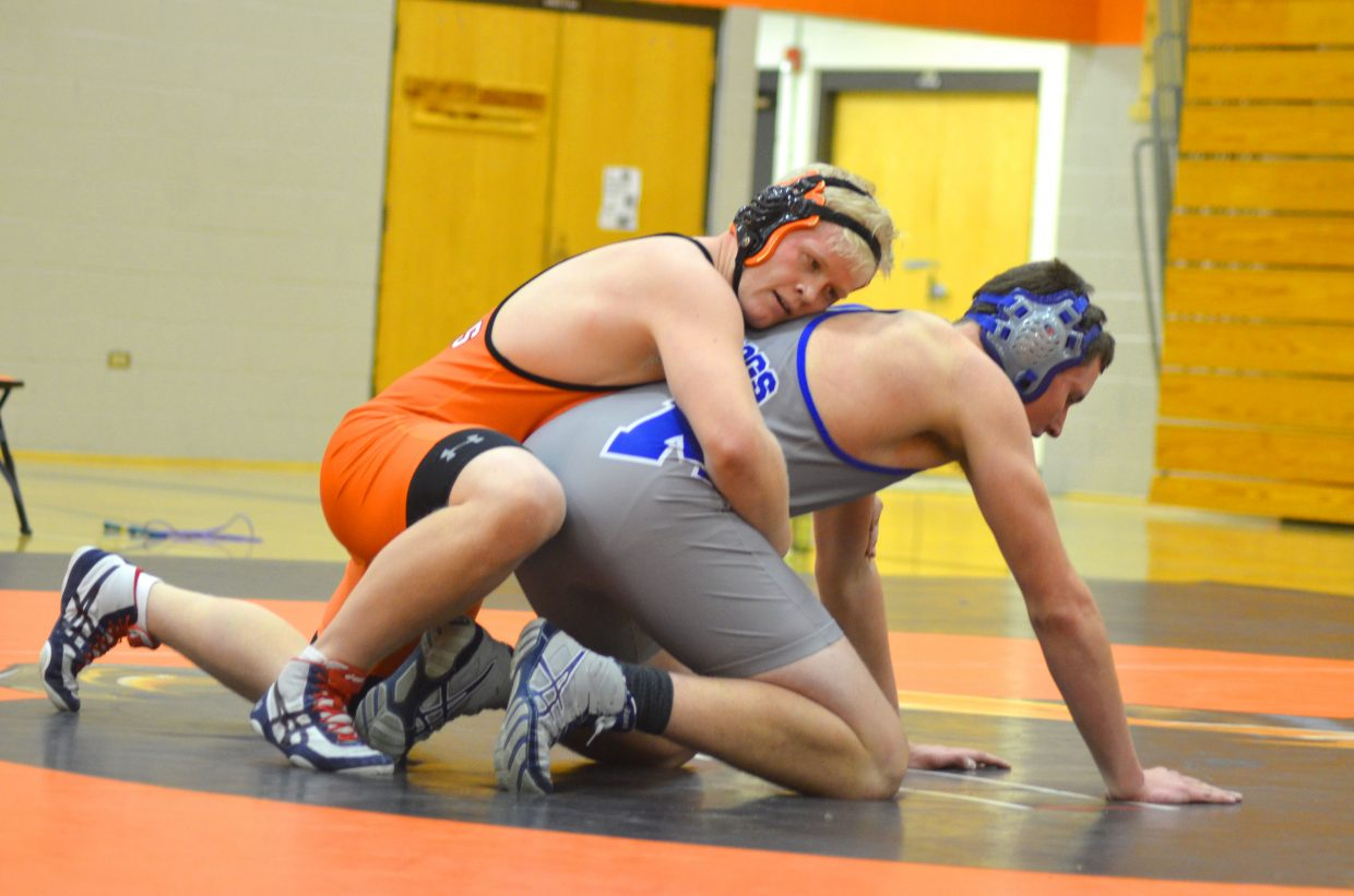 Hayden's Christian Carson, left, and Moffat County's Toryn Hume get ready for another round during the dual meet between the Tiger and Bulldog wrestling teams Thursday in Hayden. Moffat County won, 62-7.