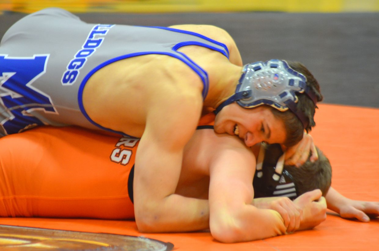 Moffat County's John T Peroulis makes sure Hayden's Blake Puckett has nowhere to go during the dual meet between the Tiger and Bulldog wrestling teams Thursday in Hayden.