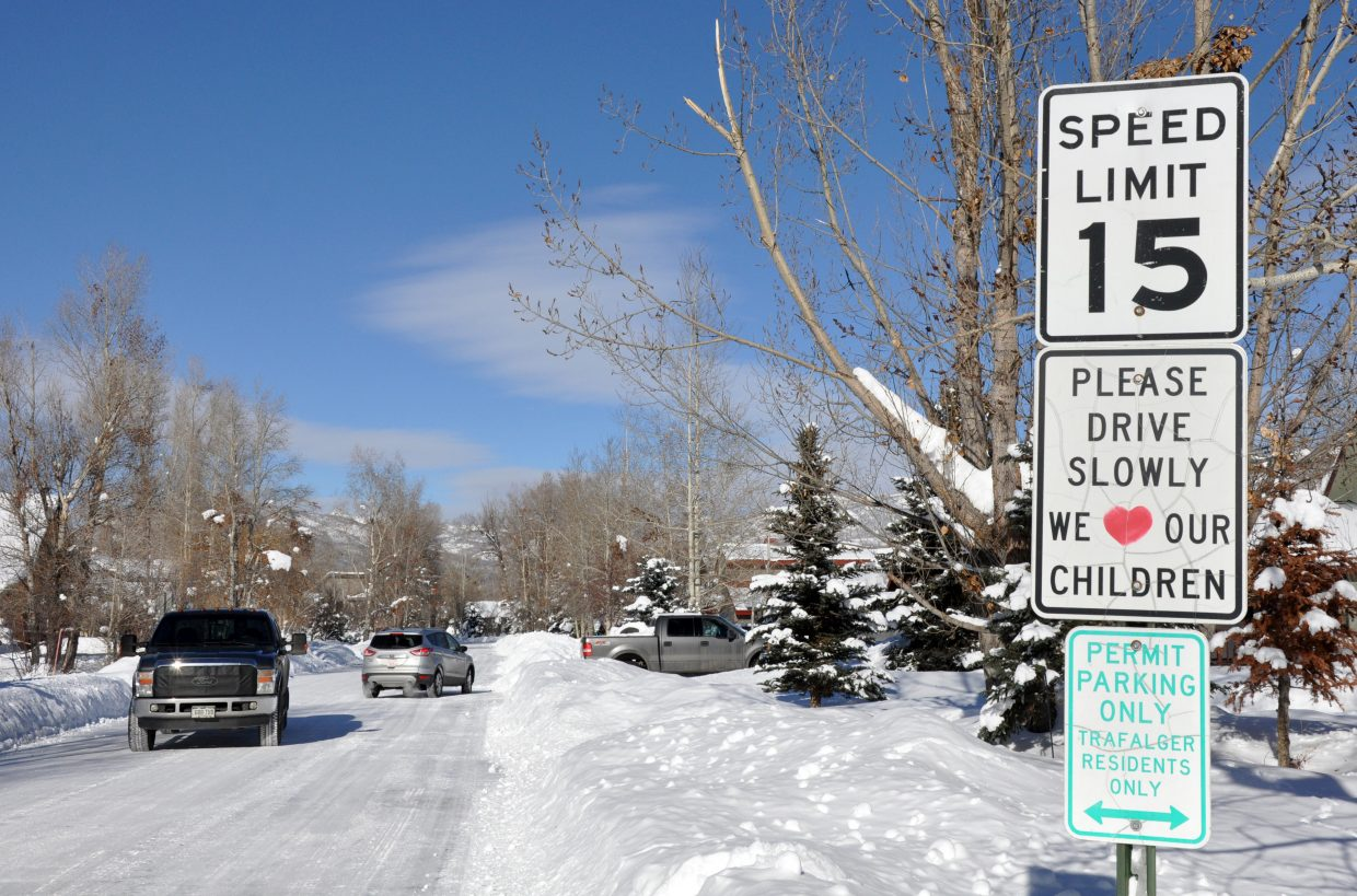 A sign on Pamela Lane advises drivers to slow down on their way out of Emerald Park. The city of Steamboat is planning to create a new access to the park that does not run through Pamela Lane.