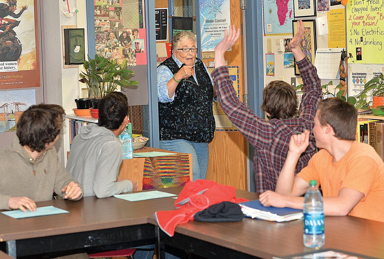 """Steamboat Springs High School teacher Sandy Conlin gets a surprise as she enters her creative writing class during seventh hour Tuesday afternoon. Conlin's class opened the hour with a energetic, """"Happy Birthday."""" Conlin, a longtime teacher in Steamboat Springs, was celebrating her 76th birthday."""