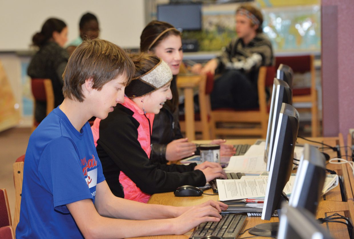 Steamboat Springs High School students Brendan Andrews, Teagan Ludwick and Este Wilkinson work inside the library Tuesday afternoon. Steamboat Springs School District was ranked in the top 10 school districts in the state, according to www.niche.com.