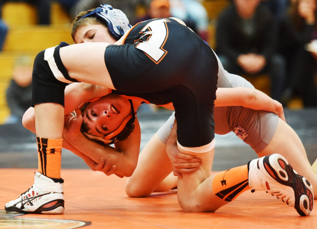 Hayden's Judd Magee wrestles Tuesday against Moffat County.