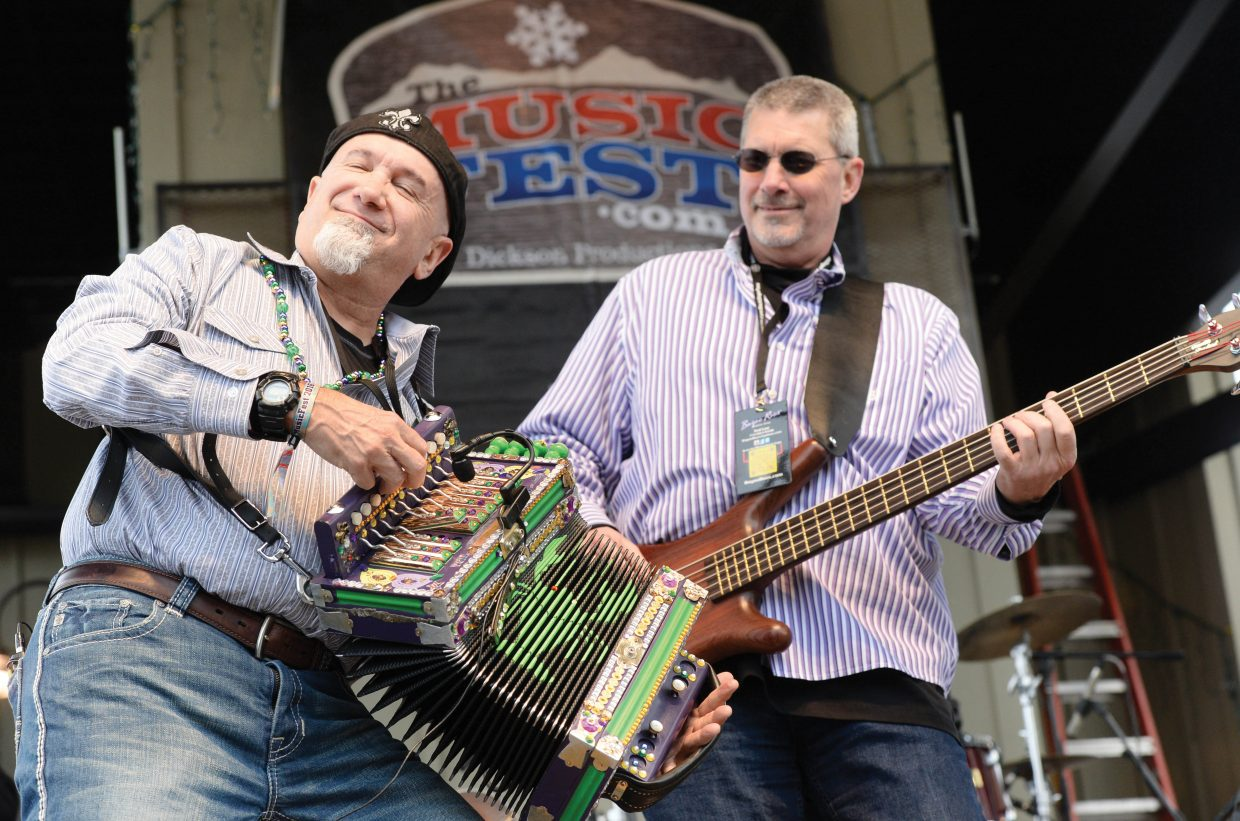 Front man and accordion player Keith Dupuis and bass player Ted Lee jam with the Cajun rock band, Bayou Roux, Wednesday at the base of the Steamboat Ski Area. Bayou Roux is just one of the bands playing free concerts on the stage at the ski area this week during the Music Fest at Steamboat. The Matt Hillyer Band and Dirty River Boys will take the stage today, and Haley Cole and Cody Johnson and the Rockin' CBJ are scheduled to play Friday. Concerts take place at 1 p.m. and 2:30 p.m. each day. On Wednesday, Bayou Roux shared the stage with The O's.