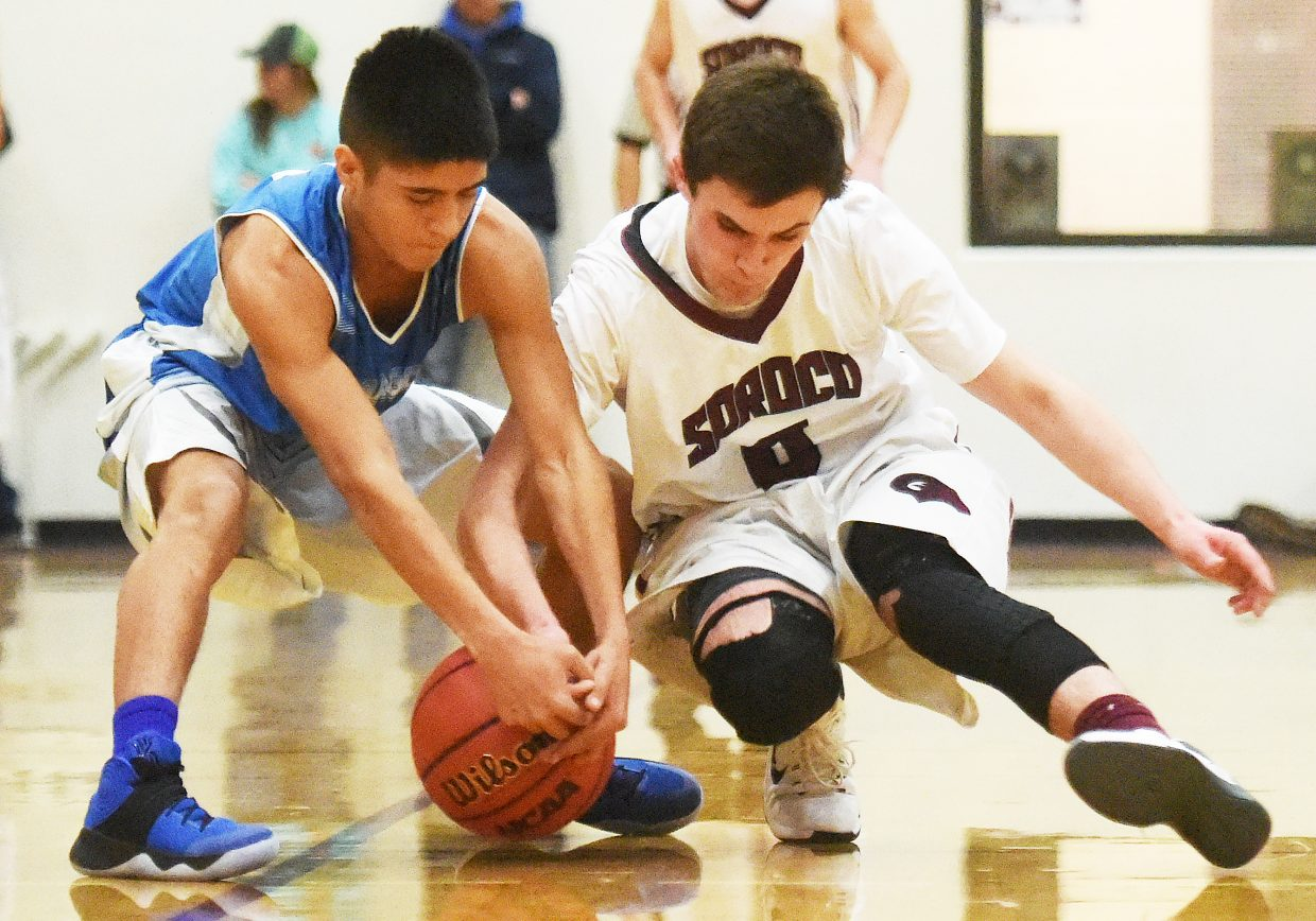 Soroco's Sarvis Anarella fights for a loose ball Friday against De Beque. Soroco trailed throughout the game and by 10 early in the fourth quarter. The Rams outscored the Dragons 30-10 in that fourth quarter, however, winning their first game of the season.
