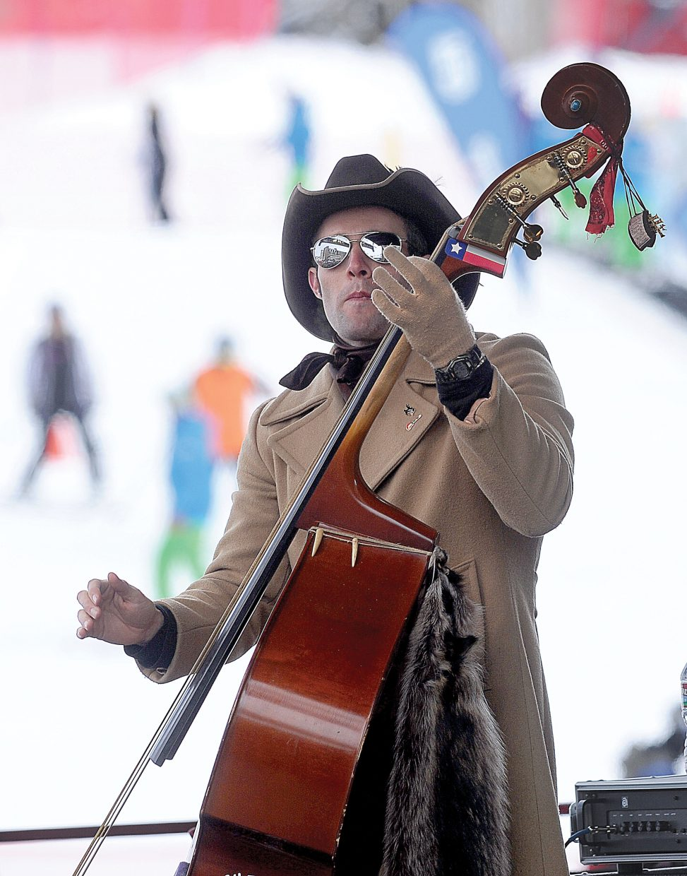 Bass player Colton James, of the Dirty River Boys, entertains a large crowd at the base of Steamboat Ski Area on Tuesday afternoon.