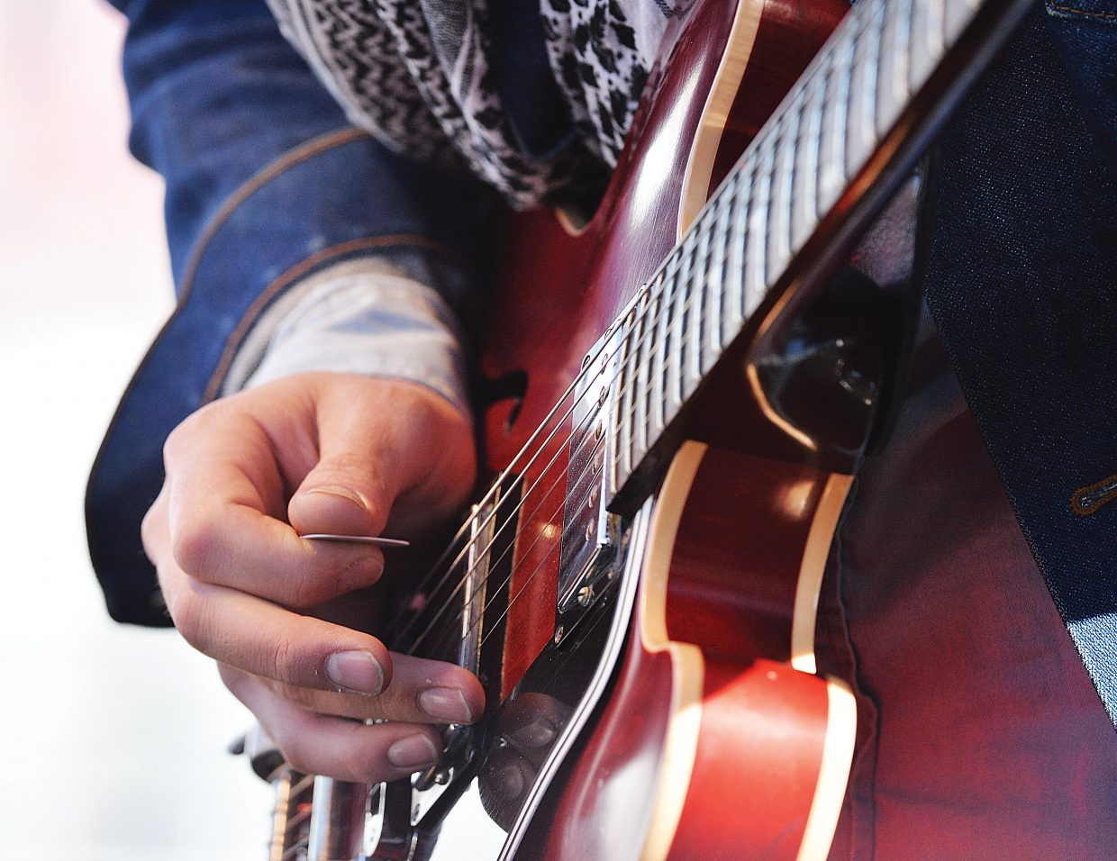 A member of Jonathan Tyler's band jams on his guitar during a free concert in Gondola Square on Wednesday.