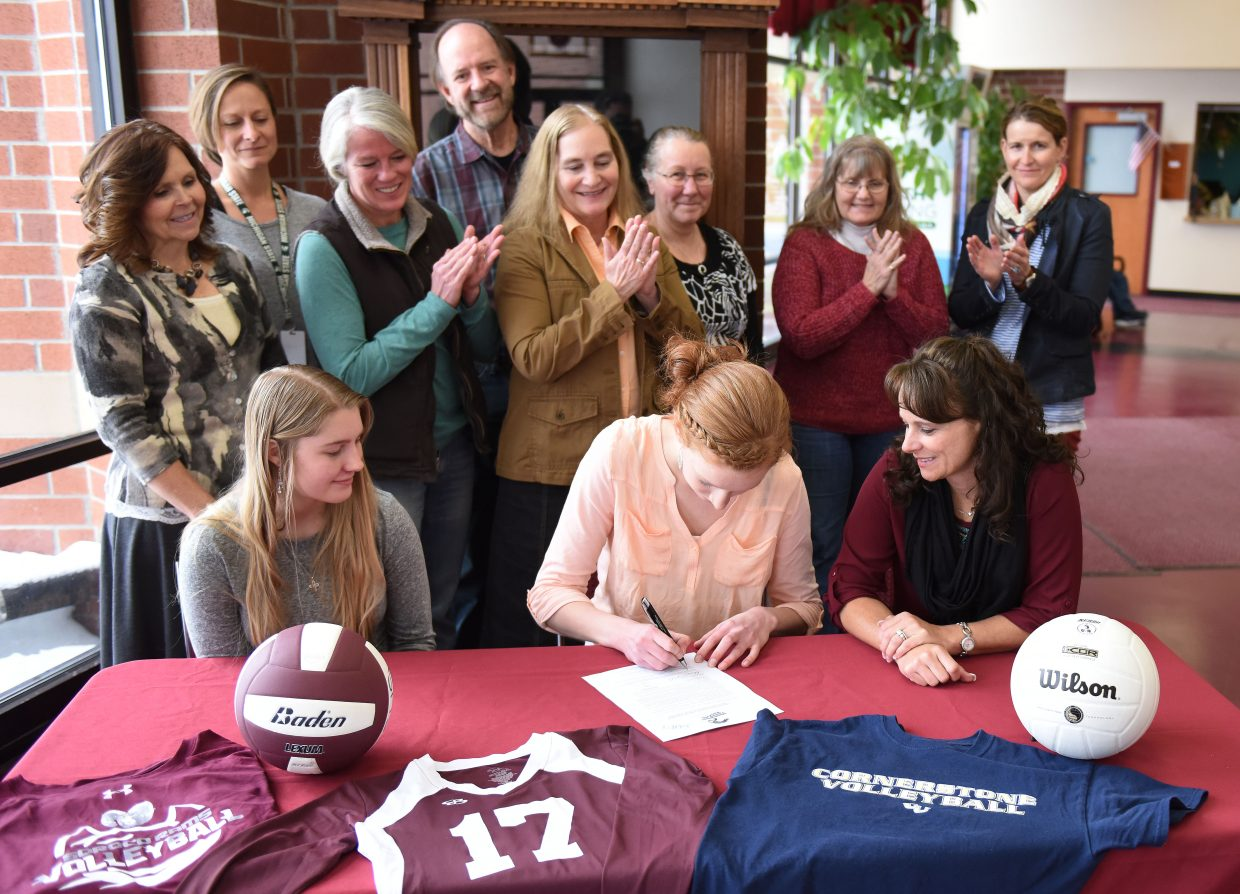 Surrounded by friends, family and teachers, Soroco senior and volleyball standout Lucy Carlson signs to attend Cornerstone University, a school in Grand Rapids, Michigan.