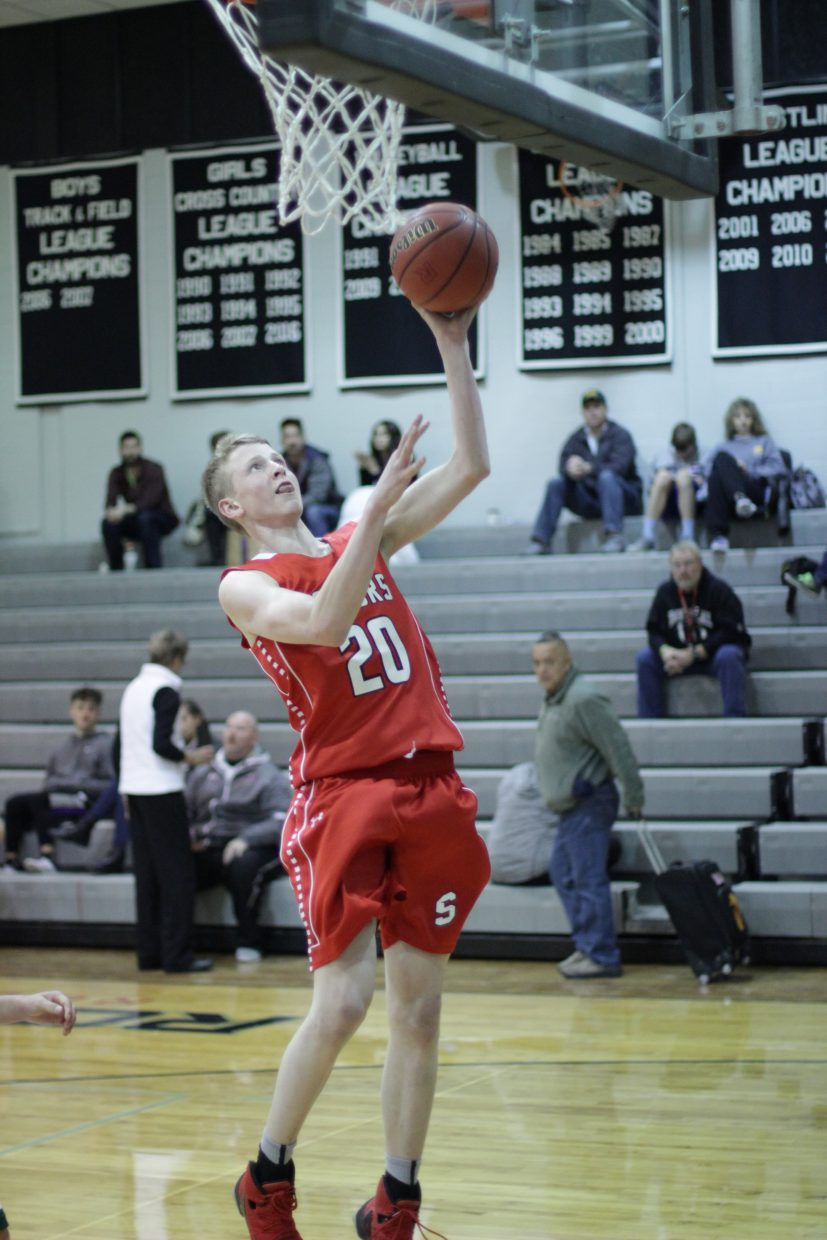 Steamboat's Mac Riniker puts up a shot during the Roughrider Shootout at Roosevelt High School.