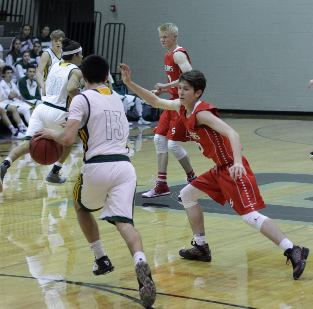 Steamboat's Connor Hansen applies defense during the Roughrider Shootout at Roosevelt High School.