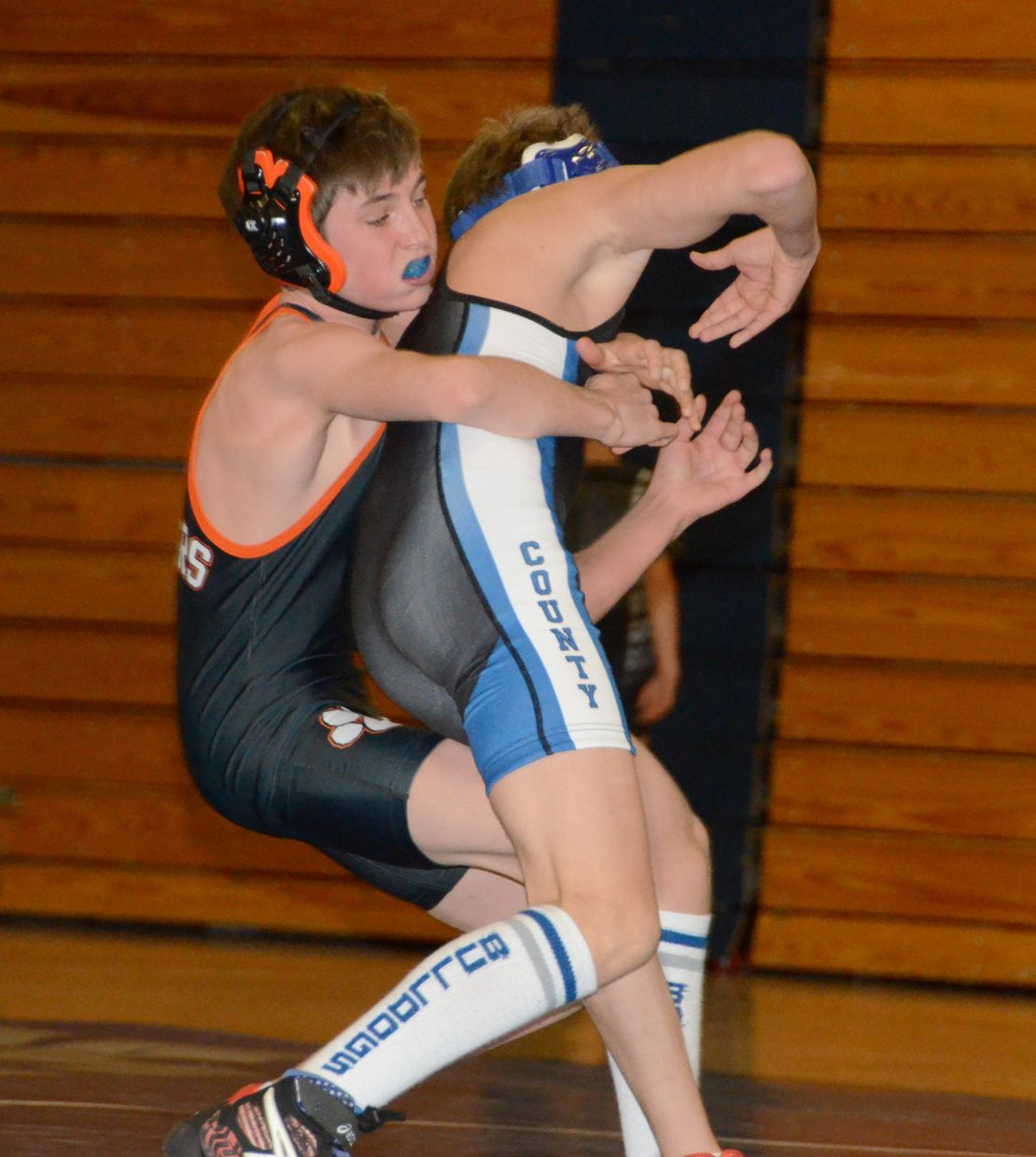 Hayden's Judd Magee tries to throw Devlyn Mosman to the mat in the 106-pound match Thursday at Moffat County High School. Magee came from behind to win, 6-5, and Hayden won the dual against Moffat County, 32-30.