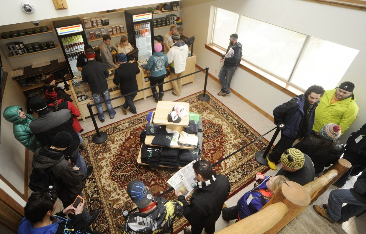 Customers line up Wednesday morning inside Rocky Mountain Remedies.