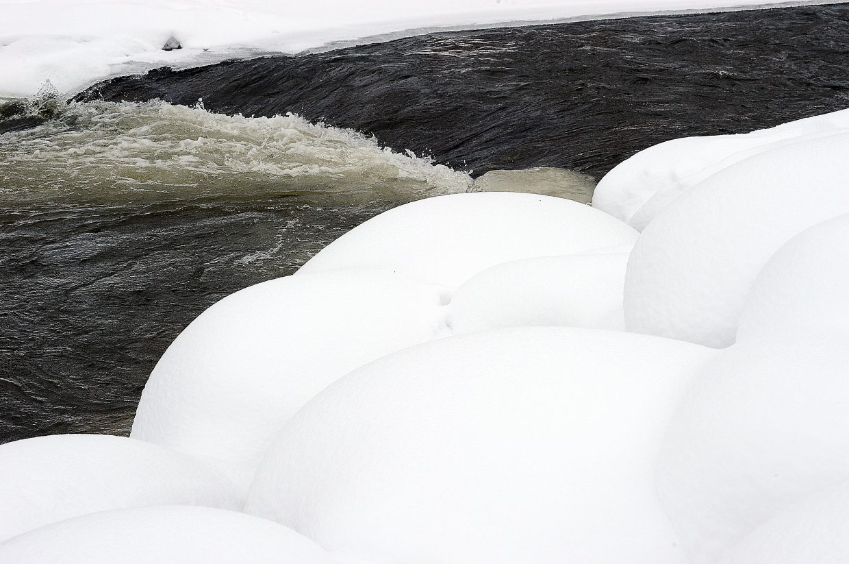 Heavy early winter storm have left the banks of the Yampa River surrounded by large snow banks thanks to an above average snowpack in the area. The snowpack is expected to increase this week as the National Weather Service has predicted several storms that are expected to bring more snow to the area.