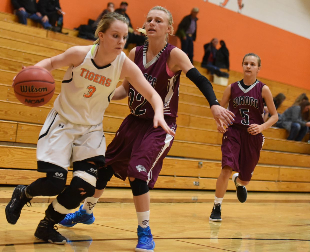 Hayden's Grace Wilkie tries to drive the ball alone the baseline Friday against Soroco.