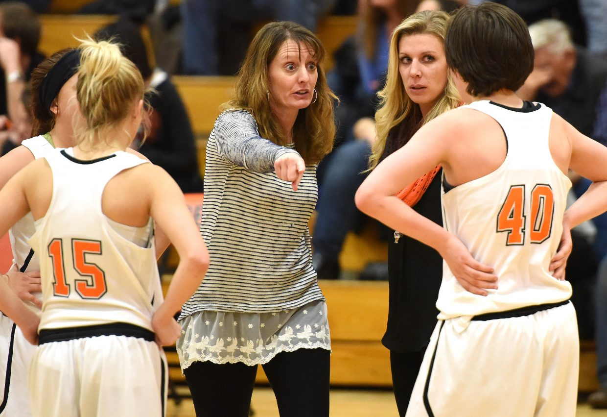Hayden coach Michelle Wilkie points out a play to her team Friday as the Tigers battled Soroco.