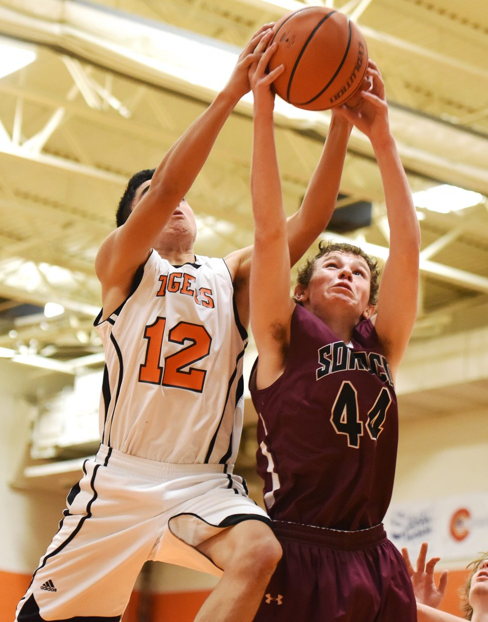 Hayden's Alan Aguirre and Soroco's Jonah Jonas fight for a rebound Friday.