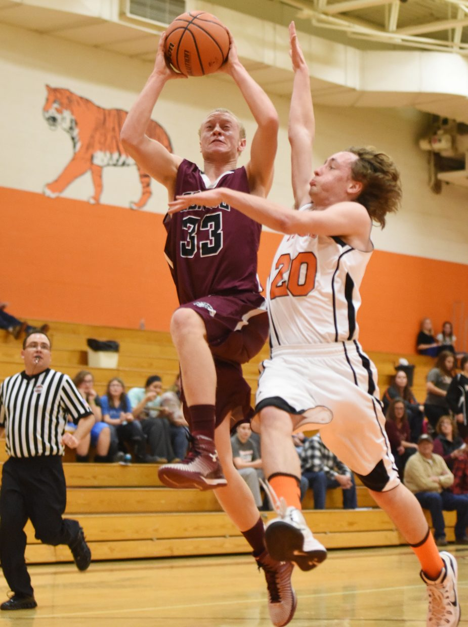 Soroco's Warren Hayes drives for a basket Friday against Hayden's Peyton Spafford on Friday.