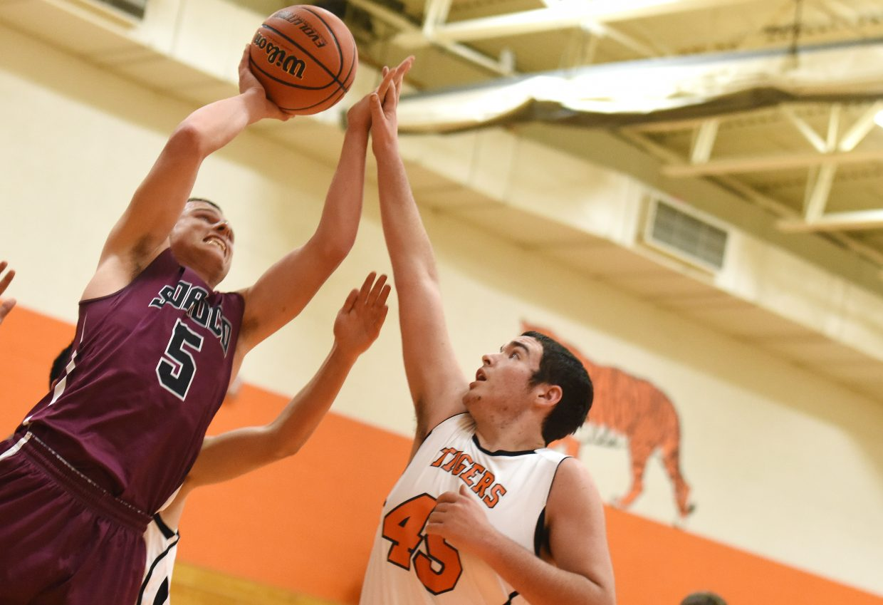 Soroco senior Eric Logan drives to the basket past Hayden's Ethan Kern on Friday. The Rams beat the Tigers, 70-14.