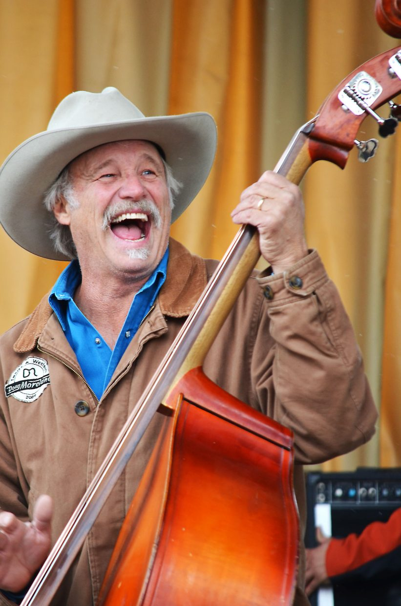 Bassist Randy Roberts doesn't let a chilly afternoon dampen his spirits while performing with the Flying Armadillos and Doug Moreland during Steamboat MusicFest at the base of the ski area Friday.