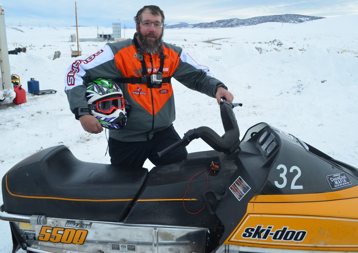 Hayden's Wyatt Case poses with his 1981 Blizzard Ski-Doo between rounds of the Vintage & Classic Oval Snowmobile Racing Saturday at Hayden Speedway. The all-day event brought in dozens of older sleds throughout the day and will run again Jan. 21.