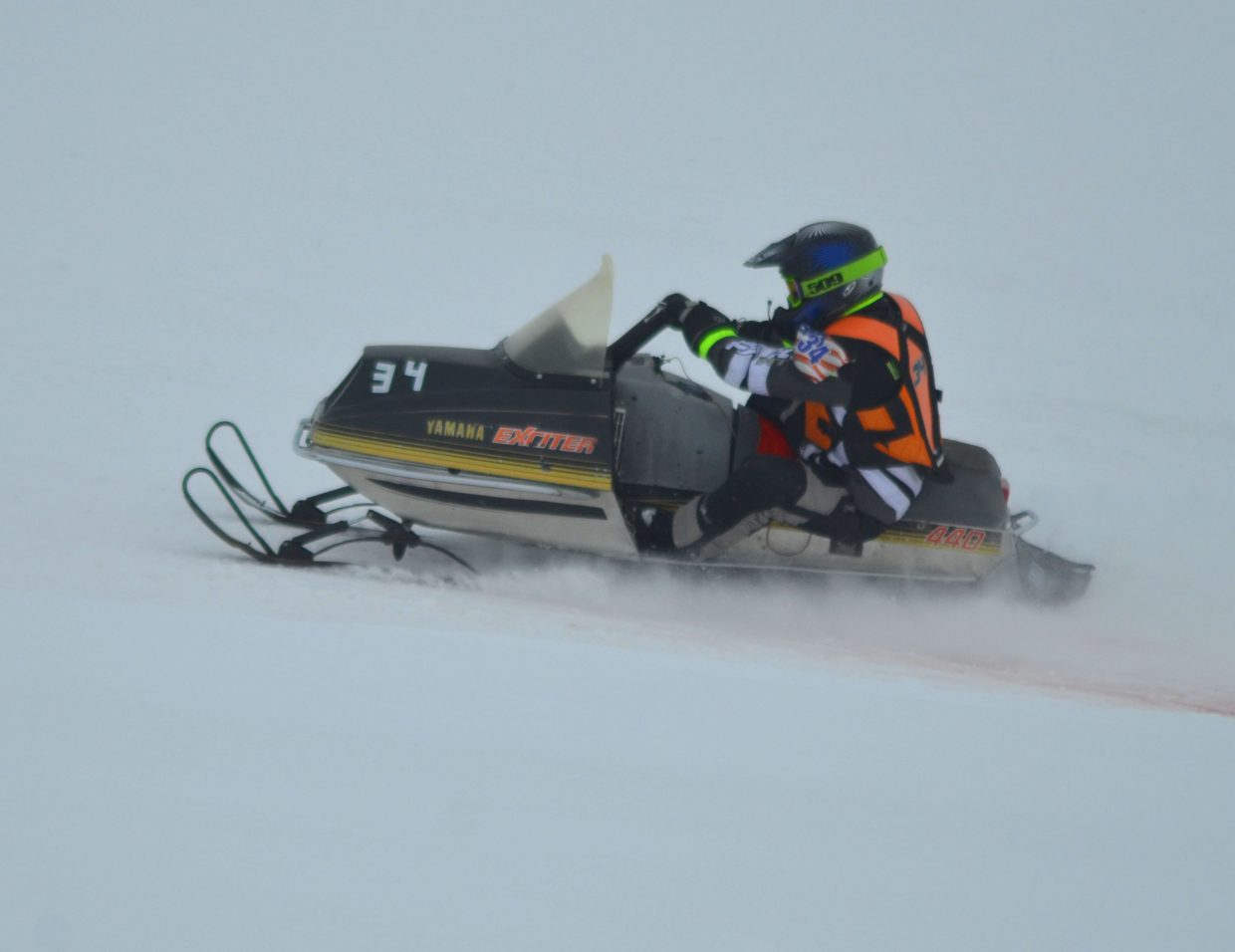 Craig's Phil Vallem kicks up powder along the track at Hayden Speedway during Saturday's Vintage & Classic Oval Snowmobile Racing.
