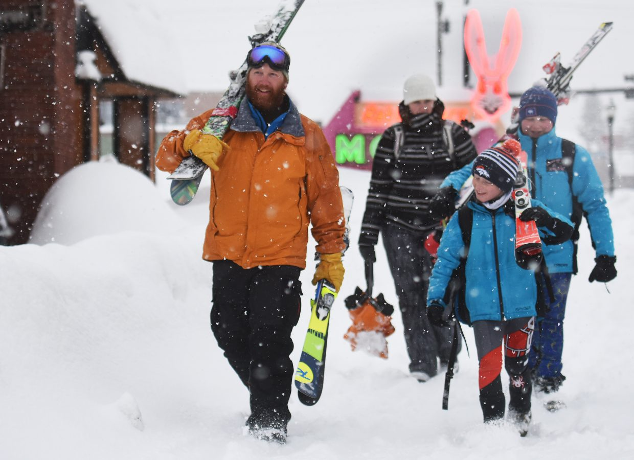 Hiking for home: Dennis Crawford, left, Amy Crawford, Jack Canepa and Cody Crawford, all of Casper, Wyoming, hike through an afternoon snowstorm after a day of skiing at Steamboat Ski Area. Jack, 10, and Cody, 11, spent Saturday and Sunday competing in the Bolle Age Class Series Giant Slalom on the All Out race course at the mountain, both coming away with top-20 results.