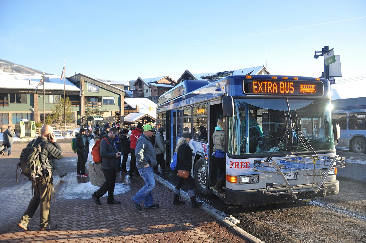 Bus riders at the Gondola Transit Center board a Blue Line on Friday afternoon. The city of Steamboat Springs is pursuing a number of things to improve a pared down bus system that is being criticized by many local riders.