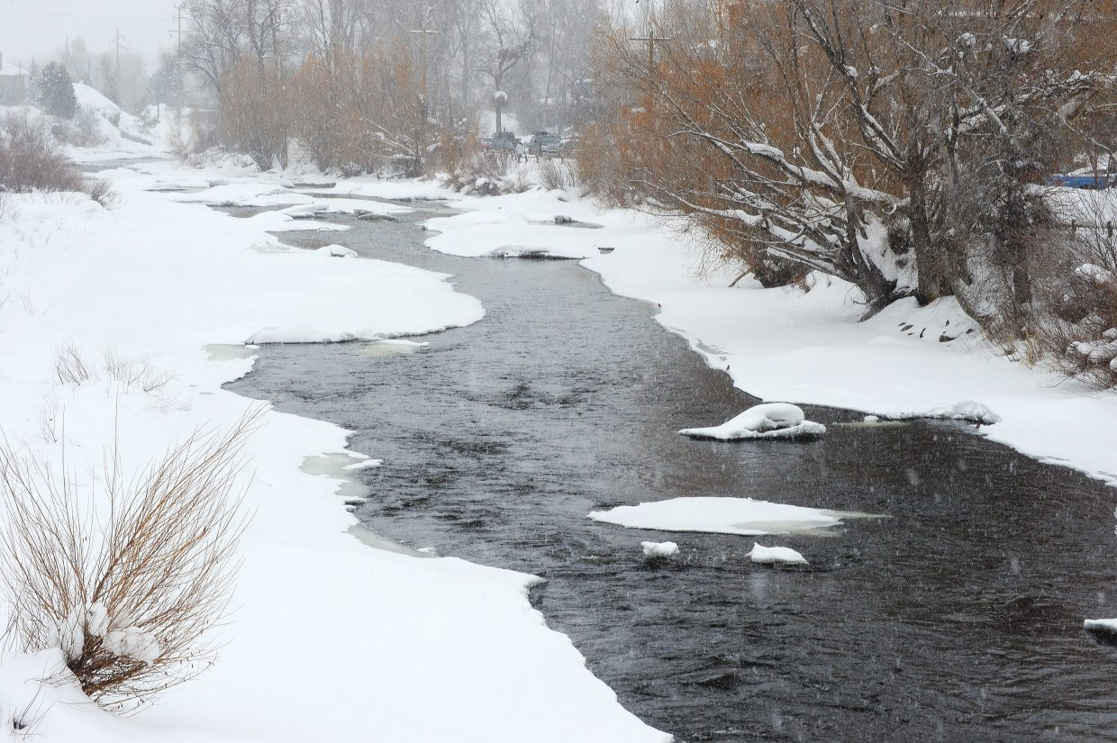 The waters of the Yampa River near the ambulance barn flow through snow-covered banks this week. A primary initiative for the Friends of the Yampa this year is to continue working with the city, Army Corps of Engineers and Colorado Parks and Wildlife to complete stream improvements in the town stretch between Little Toots Park and the ambulance barn that are called for in the formal Yampa River plan.